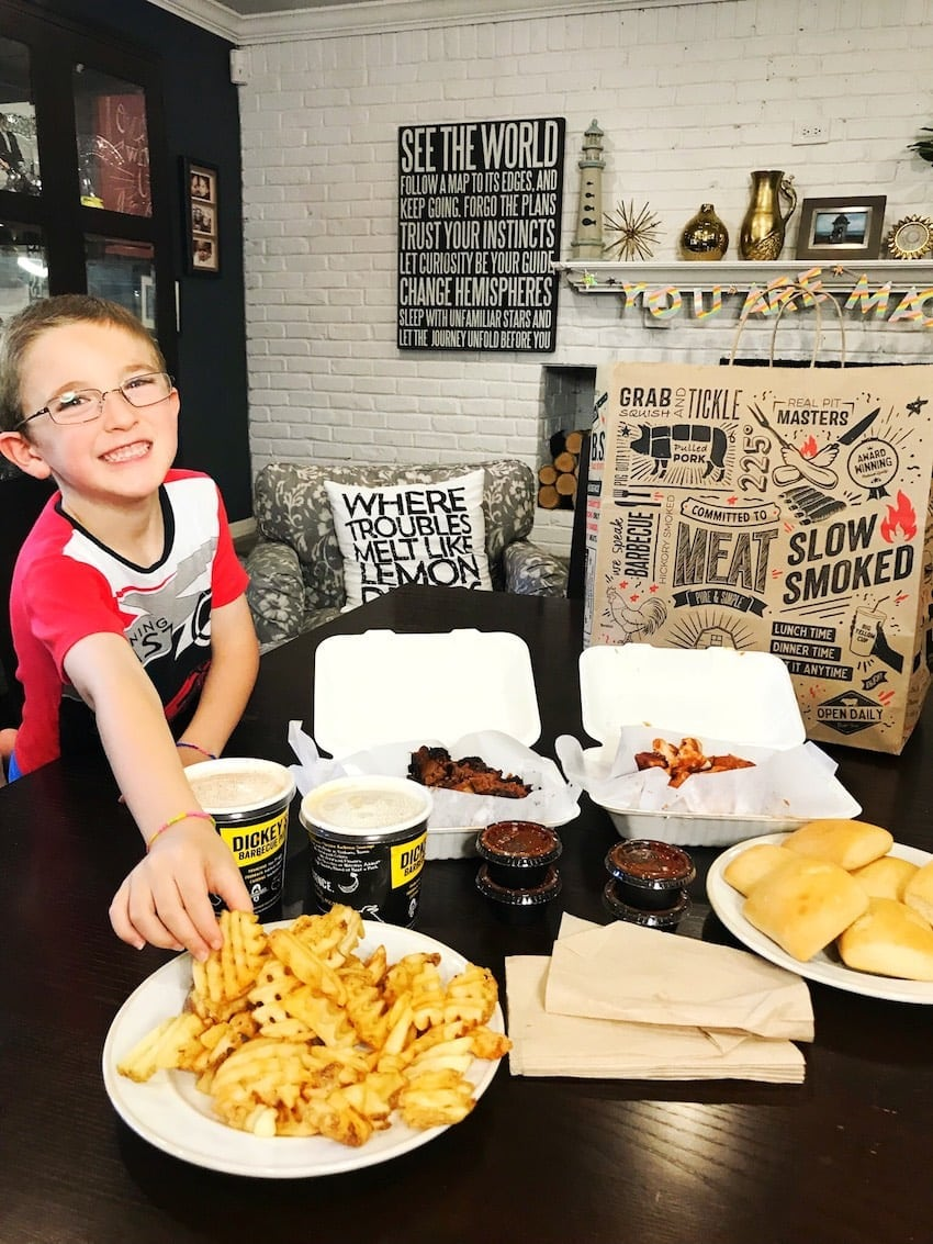 Dickey's Barbecue Pit Family Pack eating