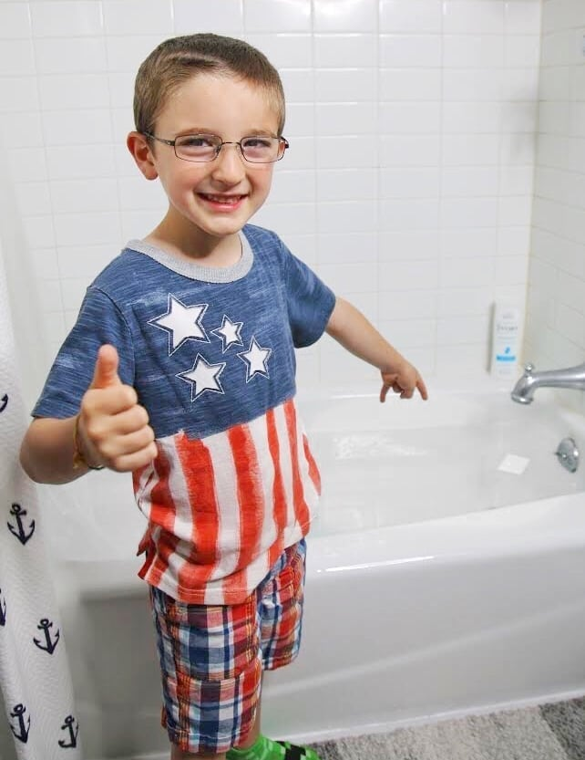 Ivory Soap bar floating in tub with happy boy
