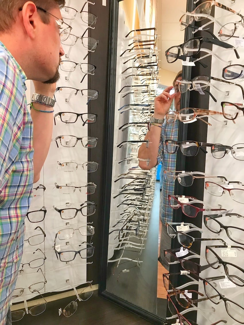Walmart Vision Center seeing new glasses in mirror