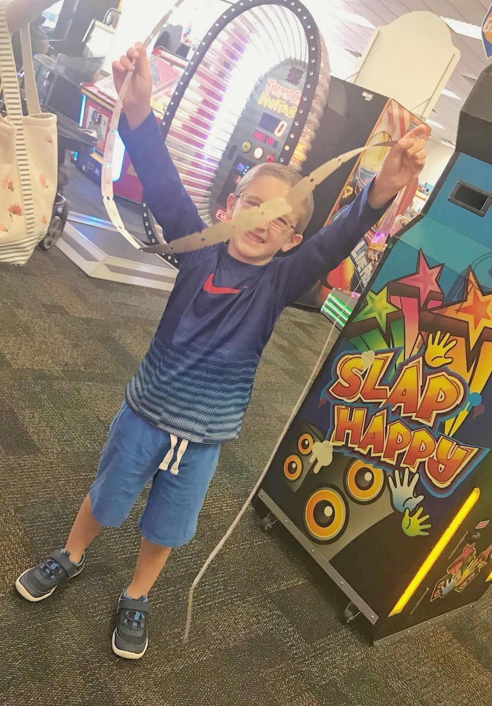 Chuck E Cheese's happy boy with tickets