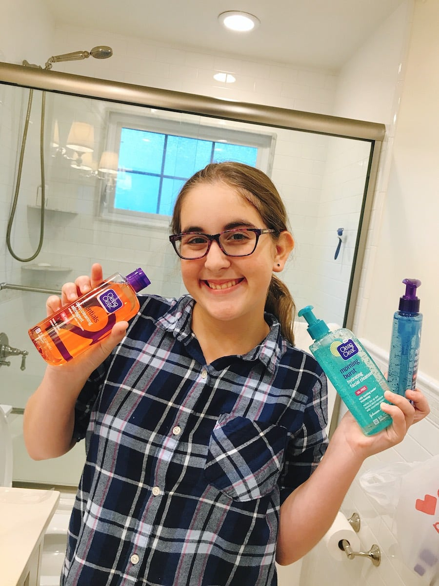 Clean & Clear products - teen girl holding up