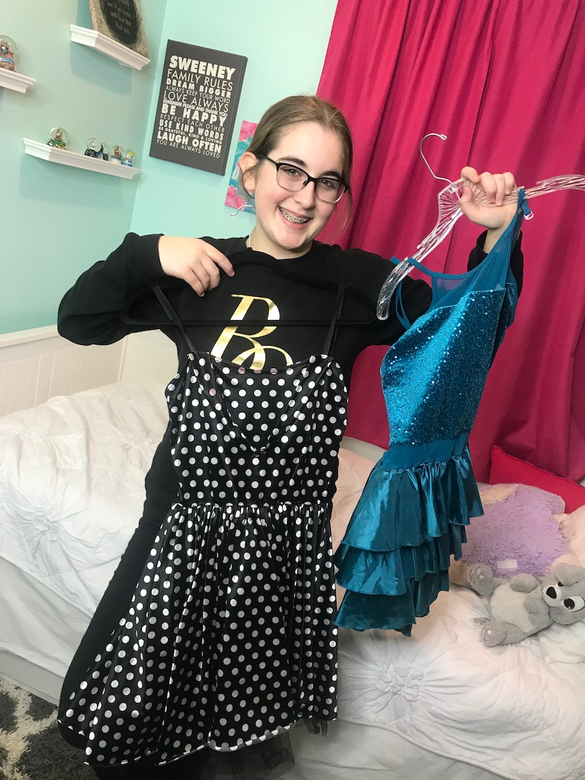 teen girl with old recital dresses