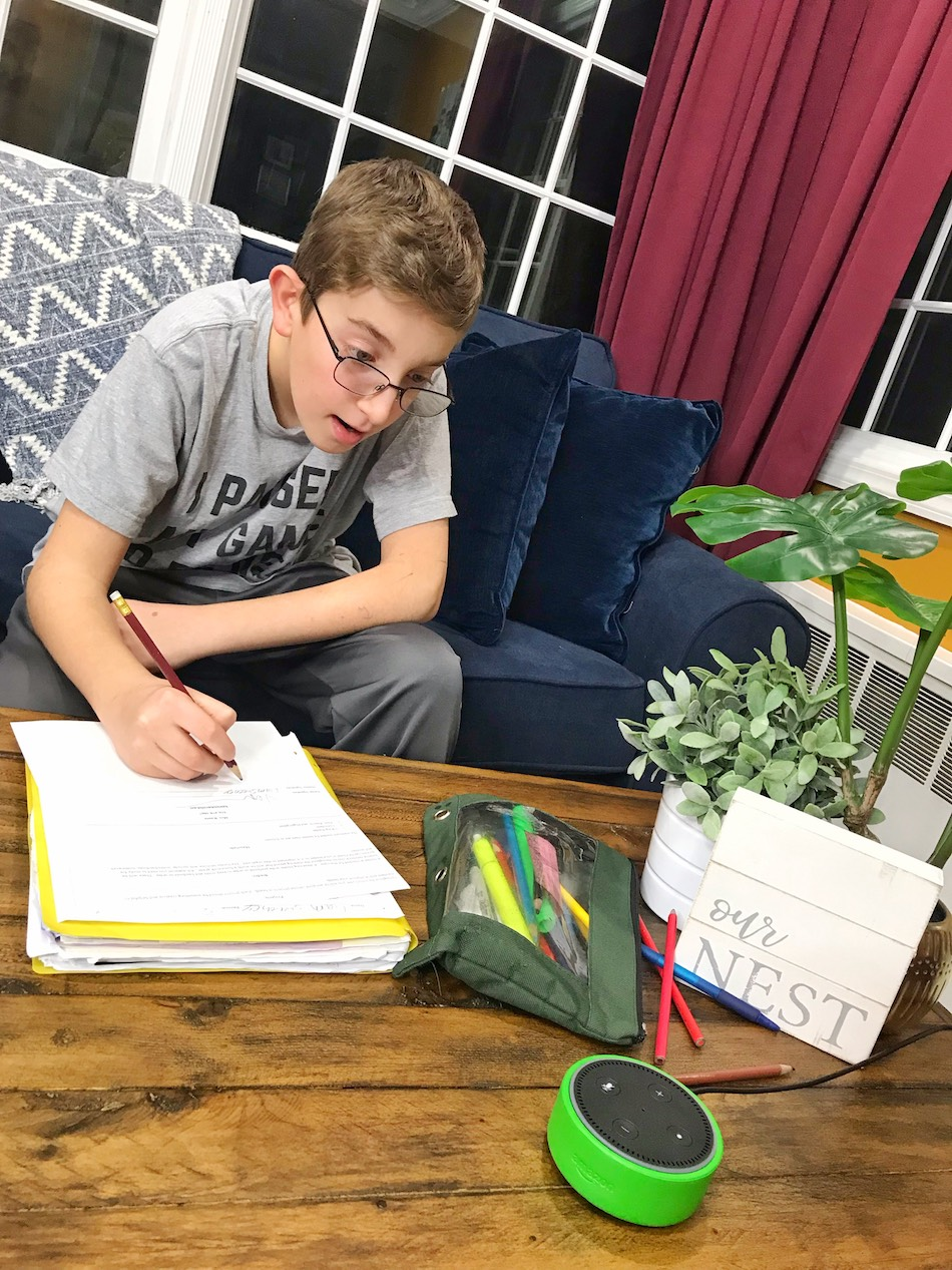 Amazon Echo Dot Kids Edition - boy doing homework