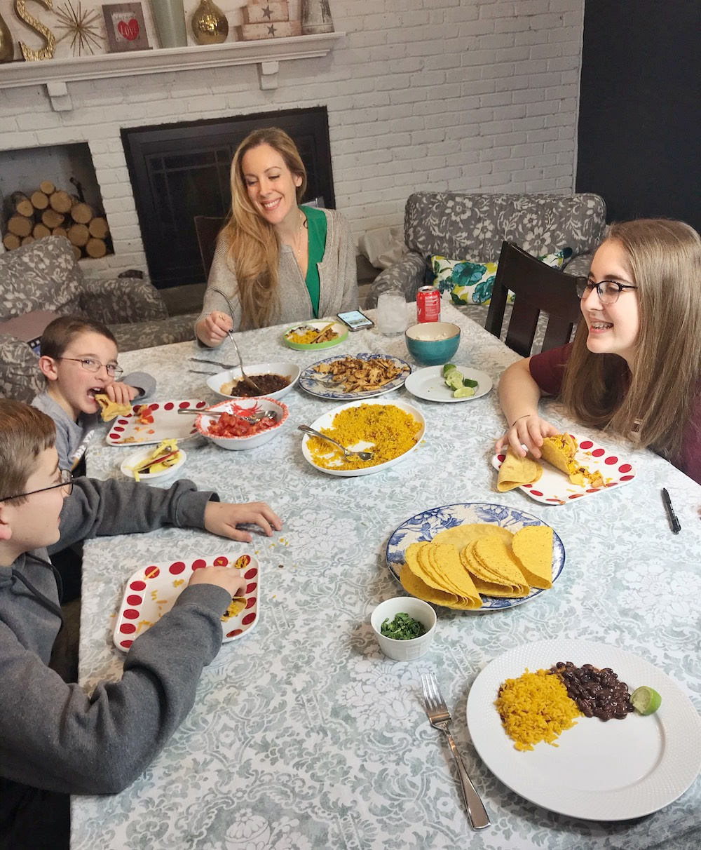 Family eating meal with BUSH'S Savory Beans