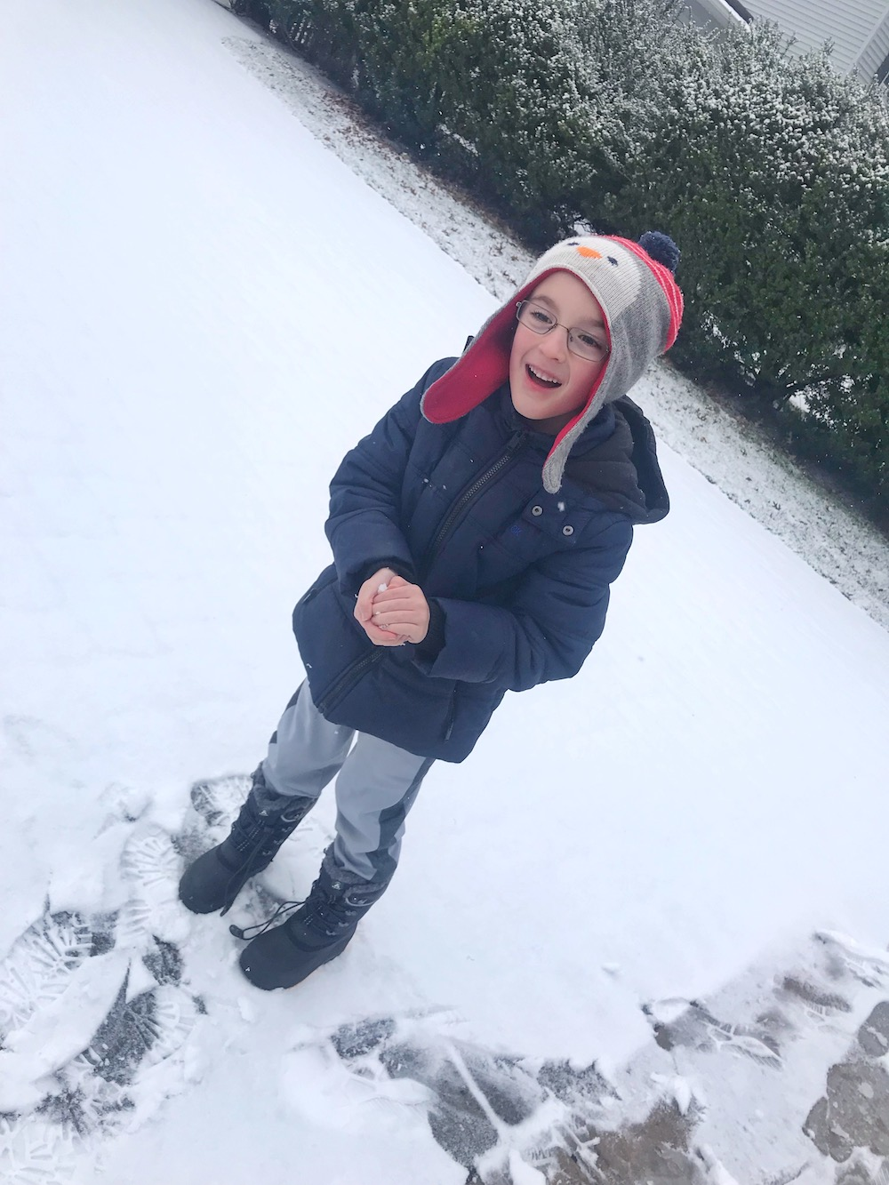 Kamik boots - boy laughing in snow #FreeYourPlay