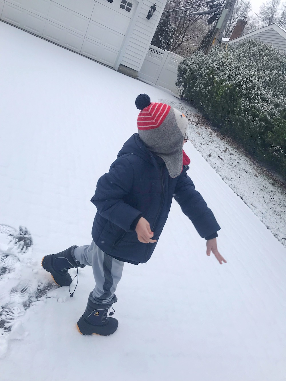 Kamik boots - boy throwing snowball 2