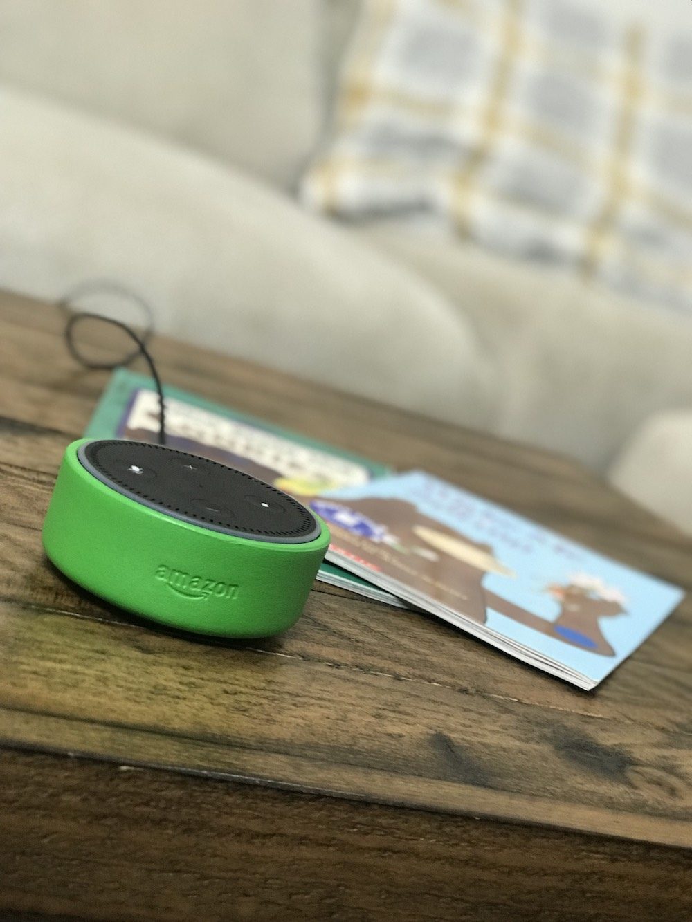 Amazon Echo Dot Kids Edition close with books