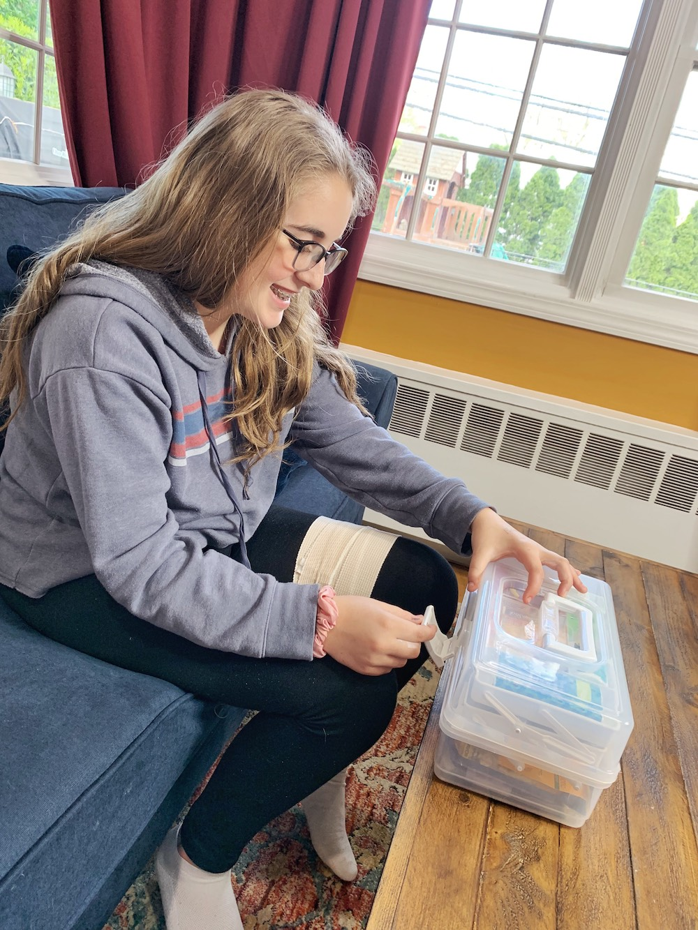 Girl closing The College Student First Aid Kit