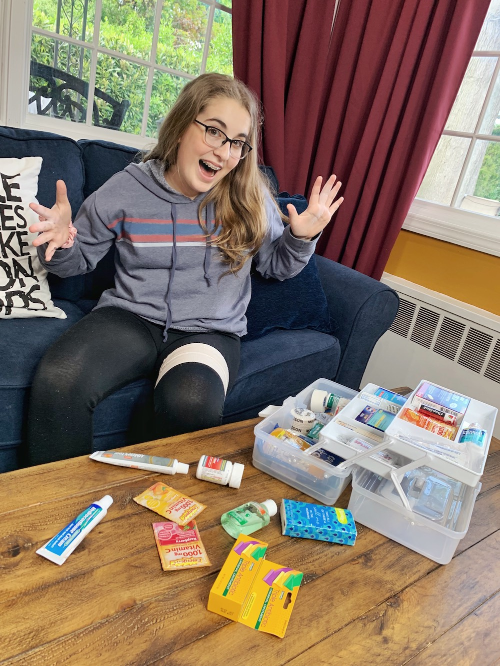 Girl using The College Student First Aid Kit