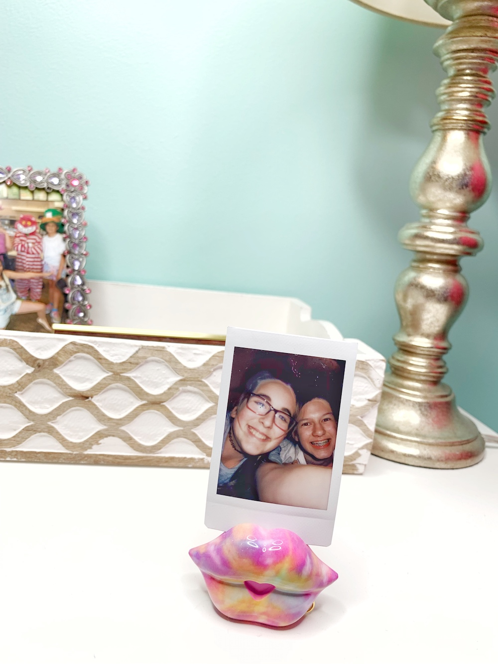 SWAK holding pic near bed