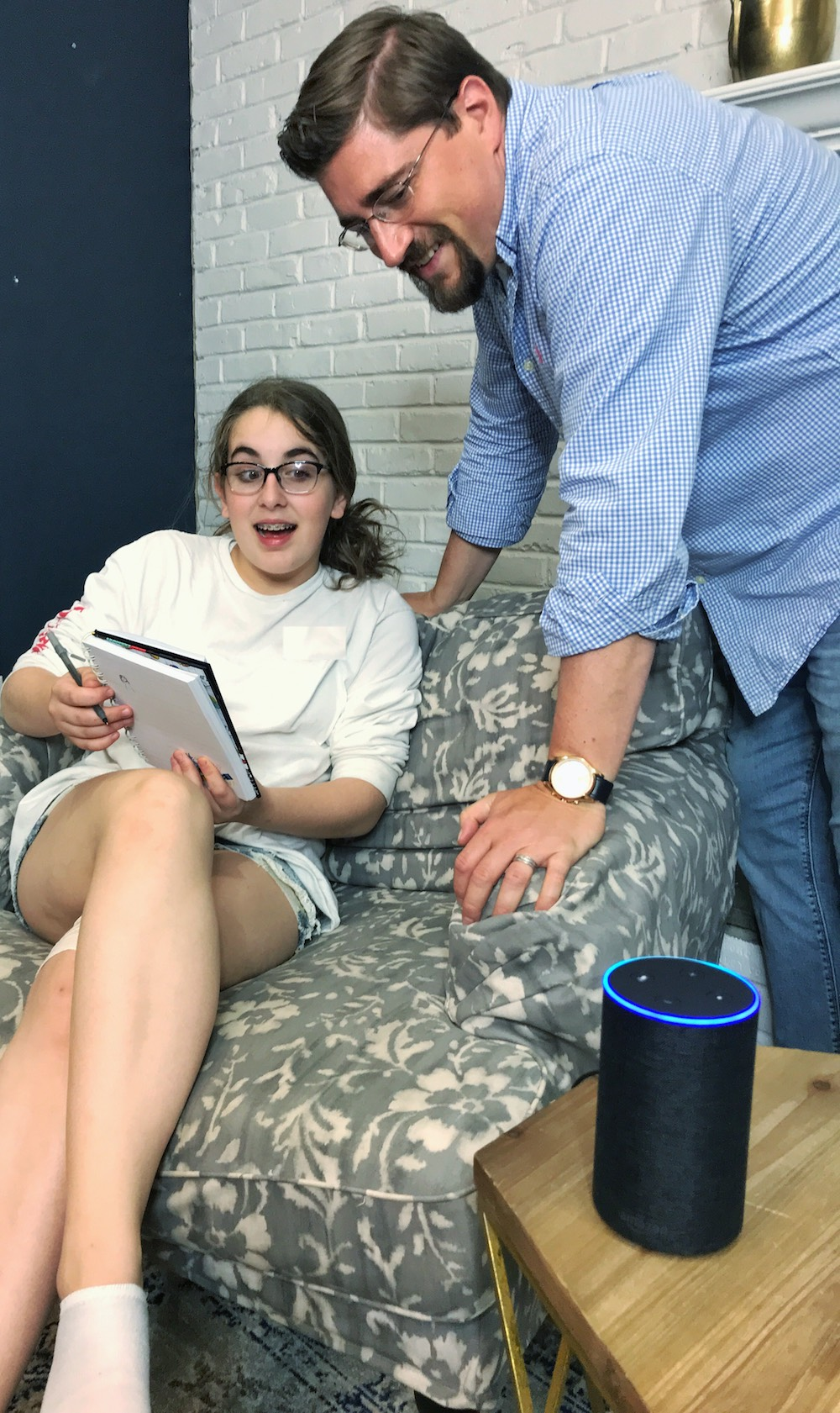 father and teen daughter using amazon echo amazon alexa