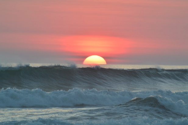 sunset over ocean waves