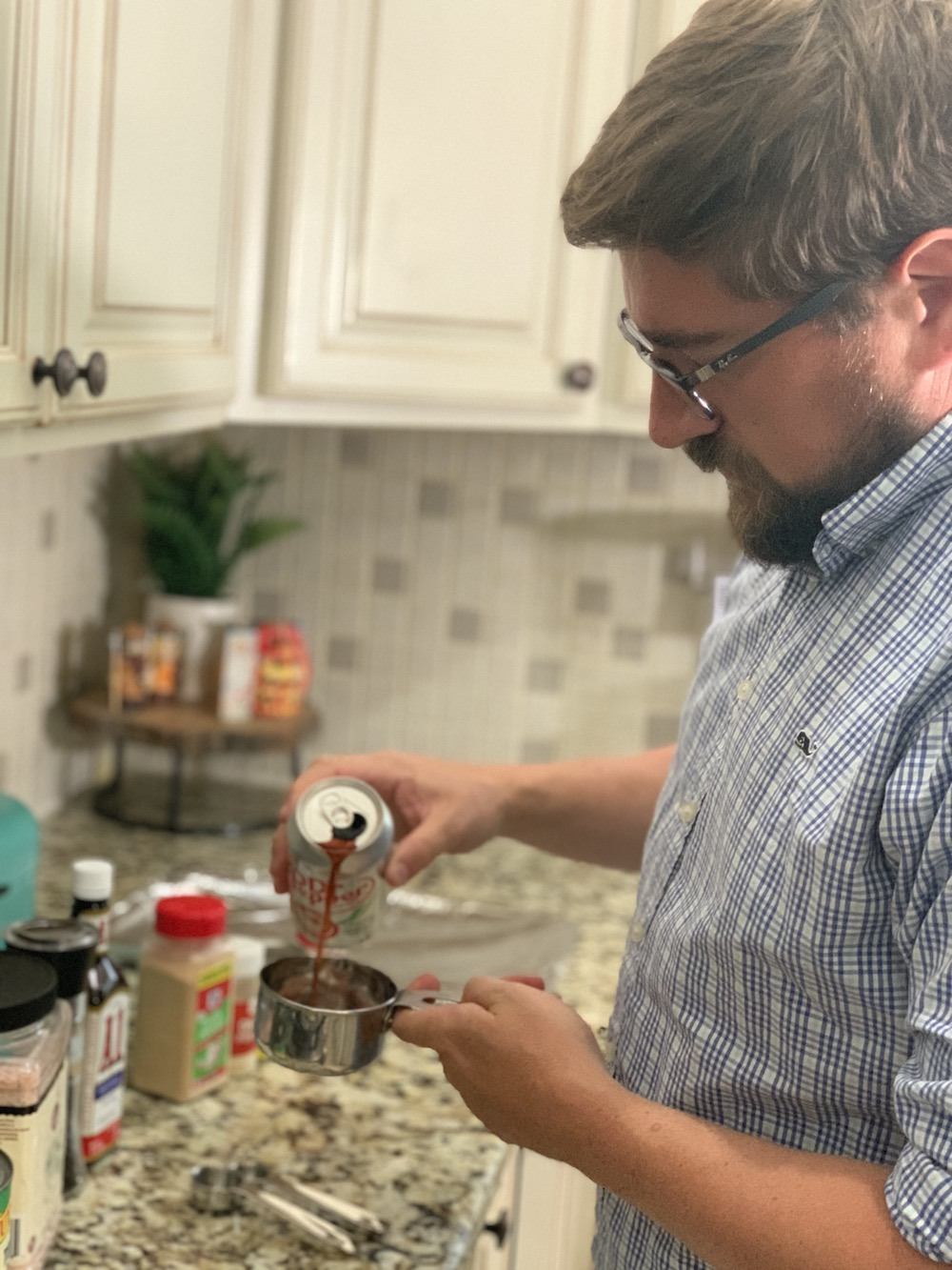 pouring Dr. Pepper for chicken